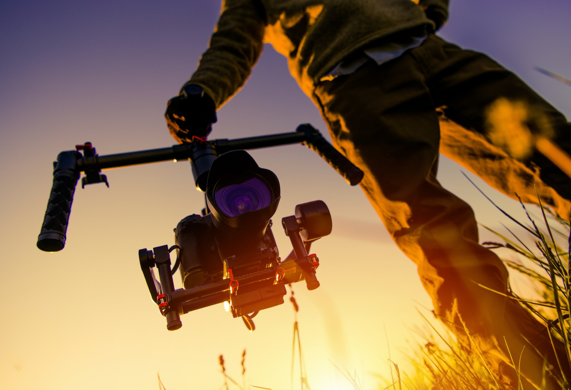 Man holding video equipment at dusk