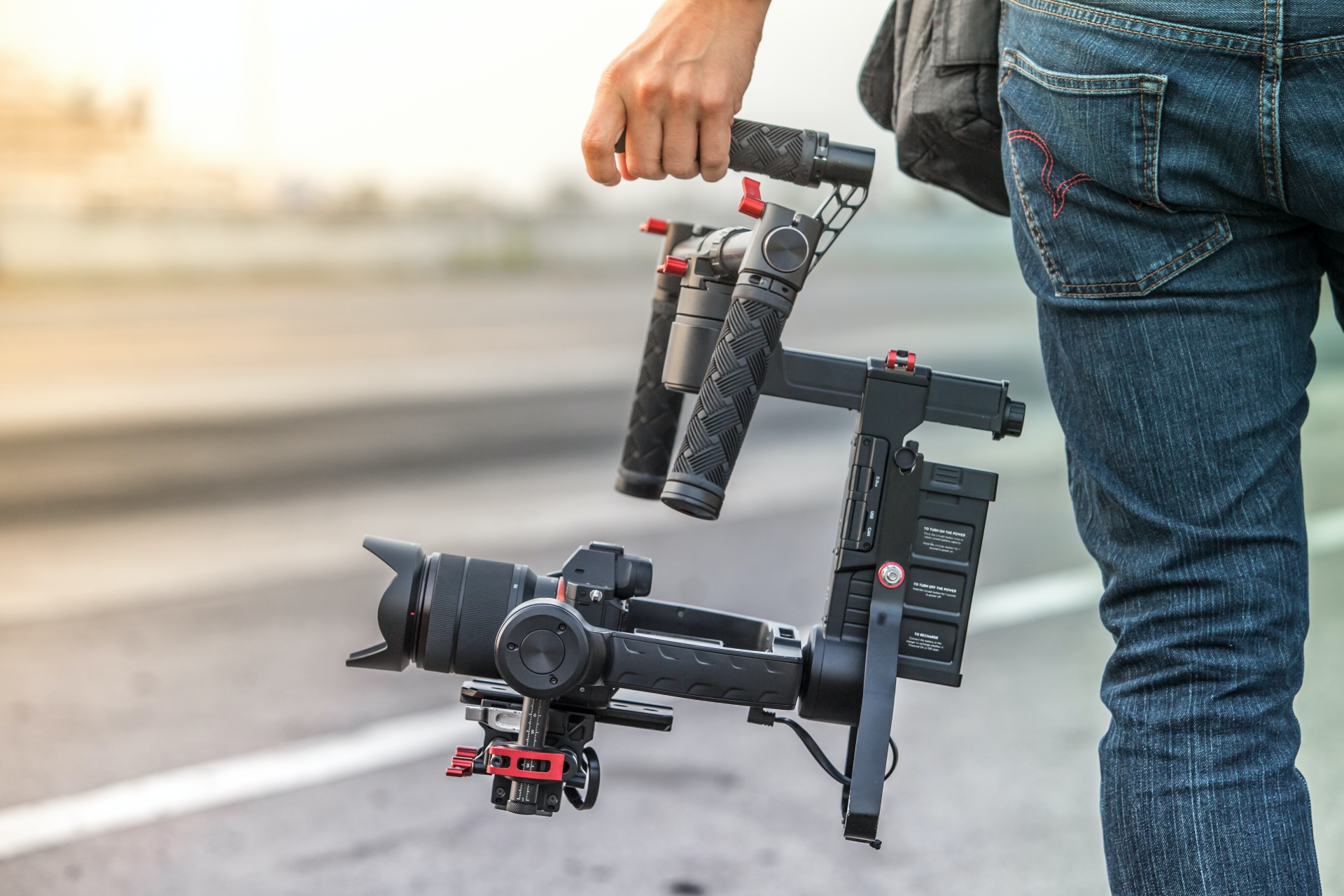 Hand holding video equipment
