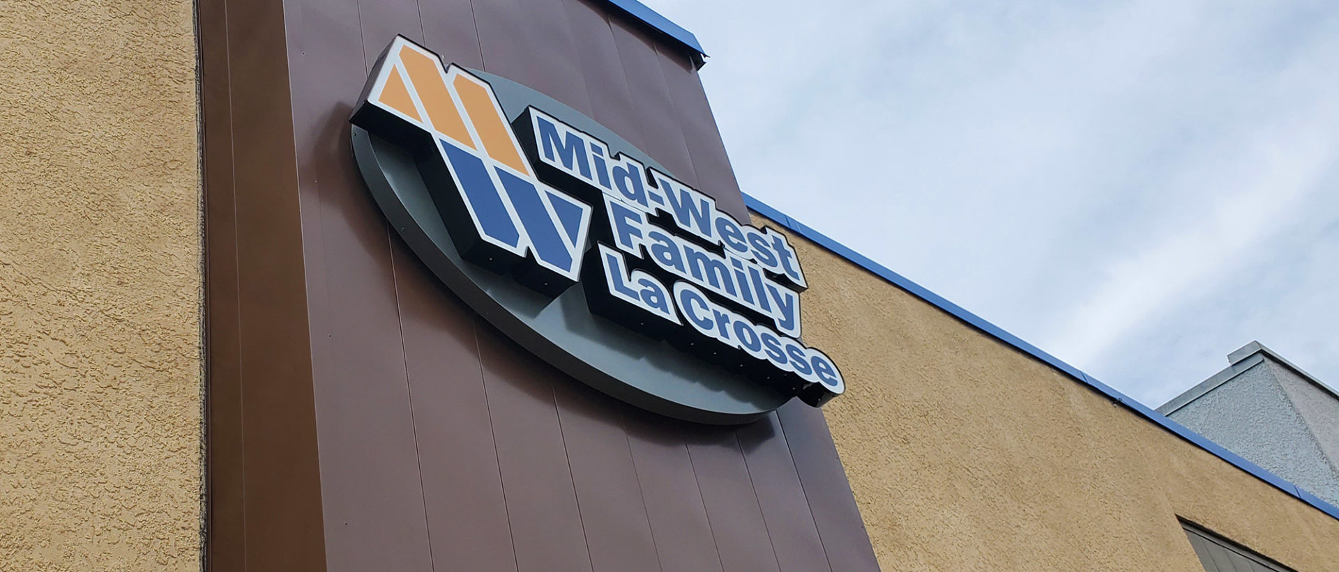 Mid-West Family La Crosse building logo